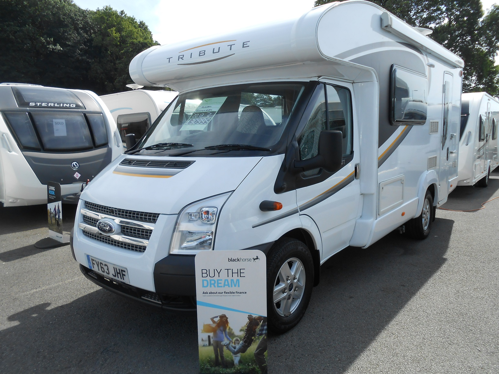 SPECIAL OFFER PRICE JUST £30995 FOR THIS 63 2013 AUTOTRAIL TRIBUTE T615 SPORT X LOW PROFILE 2 BERTH MOTORHOME IN OUTSTANDING CONDITION. The layout includes captains chairs at the front, full size bench seats which assemble into a double bed or 2 adult size single beds. Corner bathroom with cassette toilet, separate shower and hand wash basin. At the rear of the vehicle is a spacious kitchen fitted with integrated appliances including a microwave and omnivent. The Sport X Pack includes: Alloy wheels Awning Tv aerial Omnivent Cruise control Air con Reverse camera BBQ point. This Motorhome will come on the road including 12 months warranty at the advertised price. Flexible finance packages are available subject to status. Please call 07742972828 for more details. Open 7 days a week.