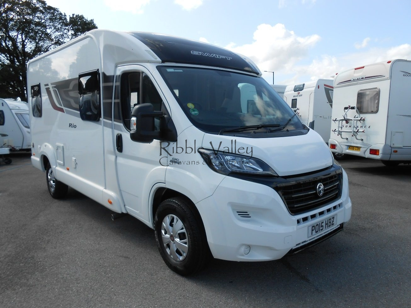 Here we have an outstanding 2015 Swift Rio 340 Low Profile Motorhome in beautiful condition throughout. The layout includes captains chairs with dinette at the front. Stylish kitchen fitted with integrated appliances. Central bathroom with shower and cassette toilet. At the rear of this motorhome is a comfortable lounge area which also assembles into a double bed. This model also includes an electric double bed that can be operated at night by just pressing a single button, and in the morning leave your bed made up and just press the button to bring the bed back to the top, this really does make life easier. This vehicle also has the tailgate that can be lifted up to give you the best view ever plus plenty of fresh air. This motorhome will come on the road fully serviced including warranty at the advertised price. We can also arrange finance packages subject to status. Please call 07742972828 for more details. Open 7 days a week. Part exchange welcome.